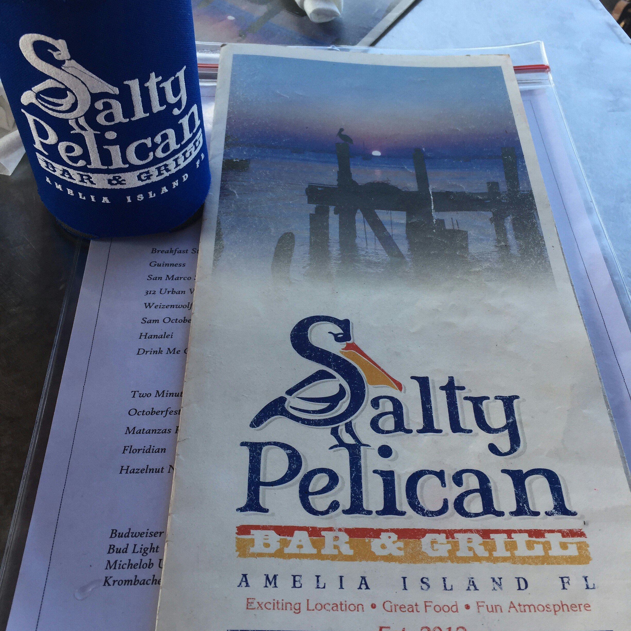 Picture of a menu and beer at Salty Pelican